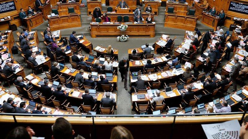 Les élus valaisans au Conseil national se positionnent au centre de leur groupe respectif.